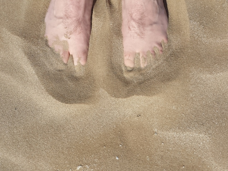 Foot in the sand of Rimini